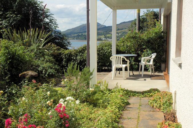 Tigh Charrann has a pleasant and secluded garden from which there are excellent loch and mountain views.