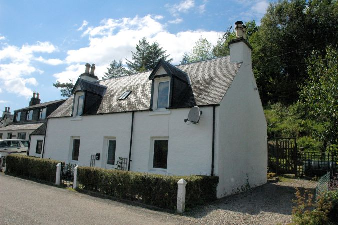 Bruaich Cottage is a traditional detached Highland cottage situated in a quiet semi-rural location towards the west end of Lochcarron village.