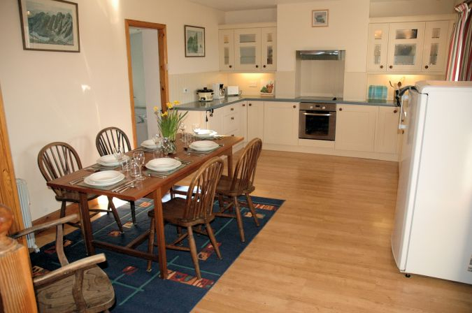 Gardener's Cottage, Lochcarron, has a very attractive and well equipped kitchen/dining room.
