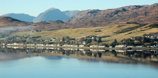 A view of Lochcarron village taken from the south side of the loch, with the Applecross mountains prominent in the background.
