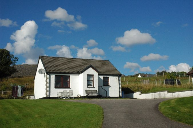 Tarlogie is a modern holiday bungalow situated in a quiet semi-rural position close to the centre of Lochcarron village in Wester Ross, Scottish Highlands