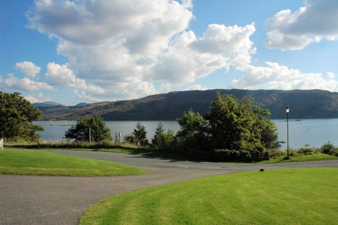 Tarlogie has a spacious open-plan garden from which there are superb views across Loch Carron to the mountains to the south.