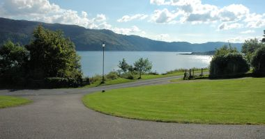 Tarlogie has a pleasant open-plan garden with a patio area from which there are excellent sea views across Loch Carron.